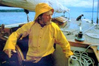 David         Baxter sailing the Lieber Schwan with his trusty little boat-nik         CoCo.